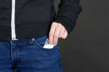 taking cocaine out of pocket