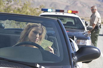 lady ticket in hand given by highway patrol