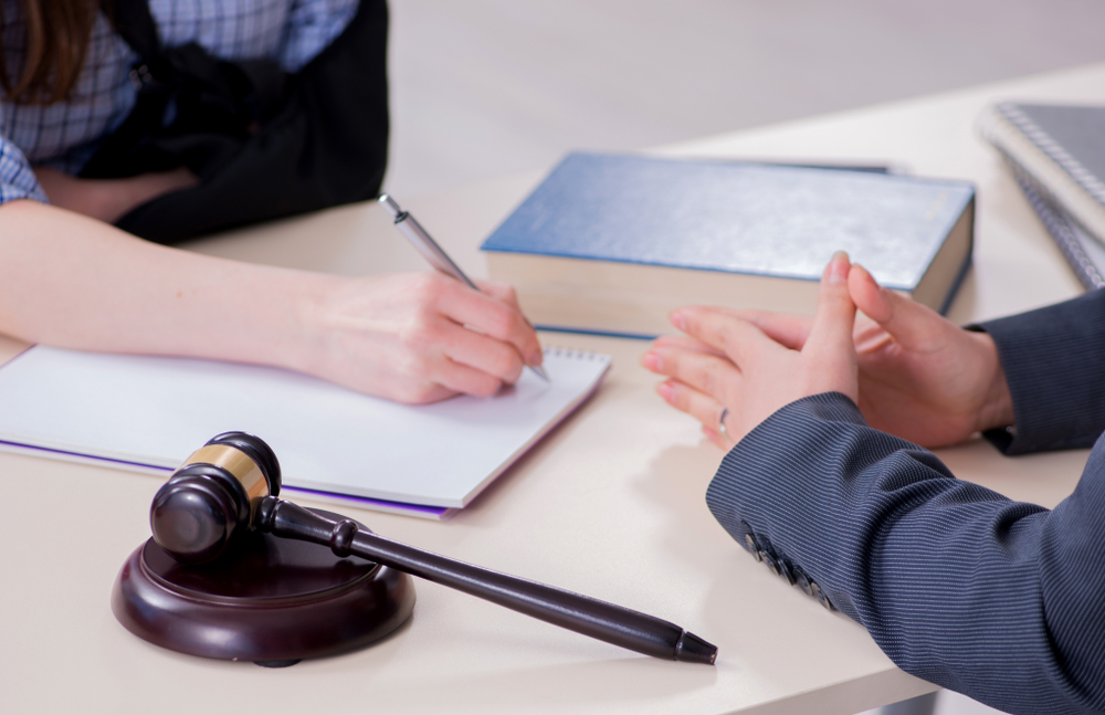 Injured Employee Visiting Lawyer For Advice On Workers' Comp Claim